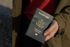 Passport in hand stock photo