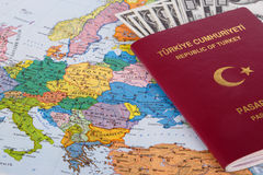 Passport with Hunded Dollar Banknotes on Map Stock Photography
