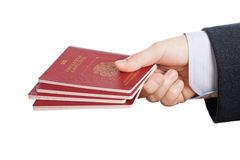 Passport ID document in hand Royalty Free Stock Photos