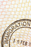 Passport page immigration rubber stamp, copy space, vertical Royalty Free Stock Images