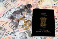 Passport on Indian rupee notes Stock Photo
