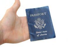 Passport Inhand. Passport being held inhand isolated Stock Image