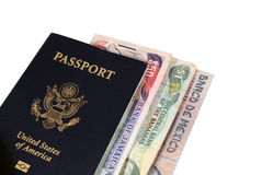 Passport with International Money. US Passport with International Money from Several Countries Royalty Free Stock Photos