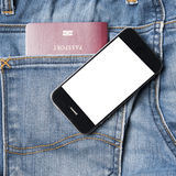 Passport in jean pocket with smart phone Stock Images