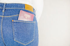 Passport in a jeans pocket Royalty Free Stock Photography