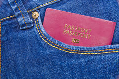 Passport in a jeans pocket Stock Photo