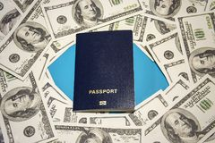 Passport and a lot of money on a blue background, travel, background royalty free stock photos
