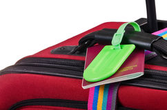 Passport and luggage tag on suitcase Stock Photos