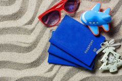Passport lying on beach sand near the plane stock images