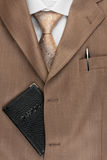Passport lying on the jacket, tie and shirt Stock Images