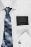 Passport lying on the shirt  and tie Royalty Free Stock Photo