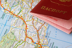 Passport and map. Fragment of red passport and a road map, horizontal Stock Images