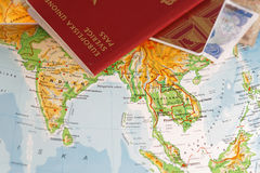 Passport and on a map of Asia including India, Thailand, Vietnam. And Burma stock photo