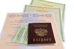 Passport with maternal, birth and insurance pension certificates Royalty Free Stock Image