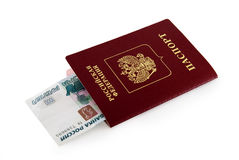 Passport and money. Money is enclosed in passport Royalty Free Stock Photography
