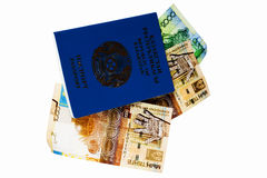 Passport and money. Passport of citizen of Kazakhstan with national currency of tenge Stock Photos