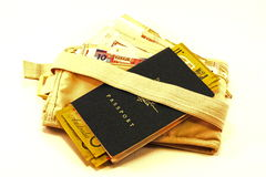 Passport with money bag with foreign currency Royalty Free Stock Image