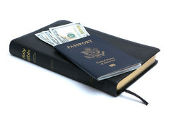 Passport, Money and Bible. The Bible instructs people to give of their finances, some people's livelihood is based on the preaching of the Bible, while others Stock Photos
