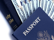 Passport, Money and Bible. The Bible instructs people to give of their finances, some people's livelihood is based on the preaching of the Bible, while others Royalty Free Stock Photography
