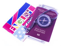 Passport, money, compass, translator Royalty Free Stock Images