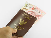 Passport and money isolated . Passport and money isolated on white background stock photos