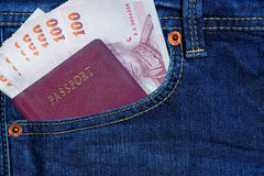 Passport and money in Jean's pocket Royalty Free Stock Image