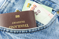 Passport and money in jeans pocket Royalty Free Stock Photos