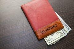 Passport with money Stock Image
