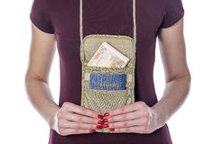 Passport and money in the mobile bag. Royalty Free Stock Image