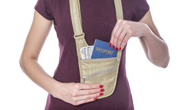 Passport and money in the mobile bag. Stock Image