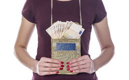 Passport and money in the mobile bag. Royalty Free Stock Photo
