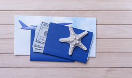 Passport money and a plane ticket. Passport and money and a plane ticket on wooden boards Royalty Free Stock Images