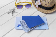 Passport and money and tickets for the rest. Still life of the traveler Stock Photo