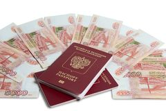 Passport and money. Travel expenses concept uncropped on white background. Money from different countries stock images