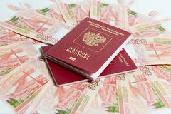 Passport and money. Travel expenses concept uncropped on white background. Money from different countries stock photography