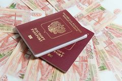 Passport and money. Travel expenses concept uncropped on white background. Money from different countries stock image