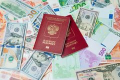 Passport and money. Travel expenses concept uncropped on white background. Money from different countries royalty free stock photos