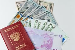 Passport and money. Travel expenses concept uncropped on white background. Money from different countries royalty free stock images