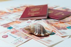 Passport and money. Travel expenses concept uncropped on white background. Money from different countries royalty free stock photo