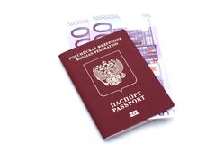 Passport and money on white background. Passport and money on a white background Royalty Free Stock Photos