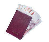 Passport and money on white background Stock Photo