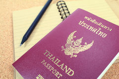 Passport and notebook. Close up of passport and notebook royalty free stock photo
