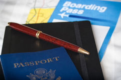 Passport notepad pen and boarding pass Stock Image