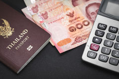 Passport, notes and calculator on black table. Stock Photography