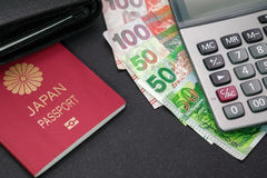 Passport, notes and calculator on black table. Royalty Free Stock Images
