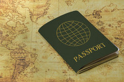 Passport on a old world map Royalty Free Stock Images