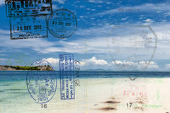 Passport over tropical paradise beach Royalty Free Stock Photography