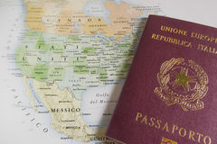 Passport over USA map. Italian passport over USA map stock photos