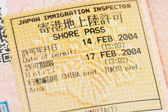 Passport page with the Japanese shore pass immigration control stamp at the Narita airport. Royalty Free Stock Image