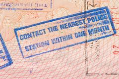 Passport page with Jordan immigration control stamp instructing to contact the nearest police station within one month. stock photos
